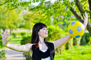 Beautiful Ukrainian girl with a ball inviting to Euro 2012