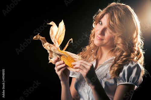 Blond girl with corncob