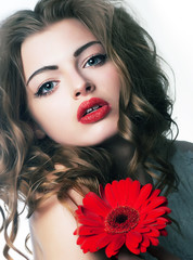 Portrait sexy woman with sensual lips and beautiful red flower