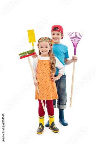 Happy gardener kids - with tools and rubber boots