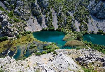 "small waterfalls and ""Kudin"" bridge on the river Krupa, Croatia"