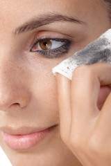 Closeup photo of removing eye makeup