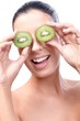 Smiling healthy woman with kiwi