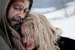Freezing homeless couple hugging