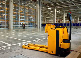 Electric forklift in storehouse