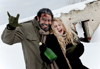 happy homeless couple drinking