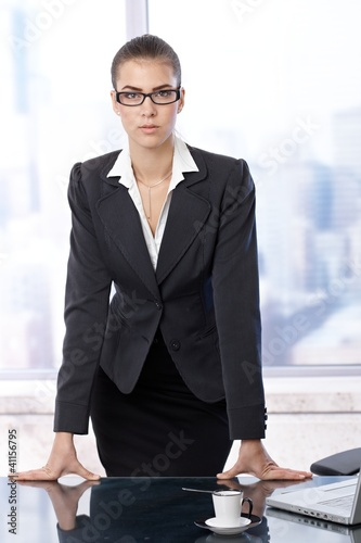 Businesswoman standing at office table