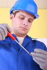 Electrician with screwdriver