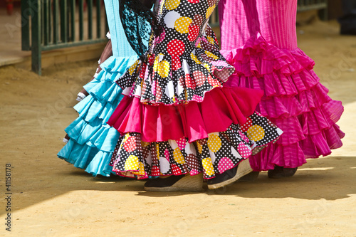 Women wearing flamenco dresses at Seville's fairground.