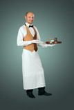 Waiter in uniform with percolator and cup of coffe.