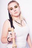 Beautiful blonde punk girl with a baseball bat