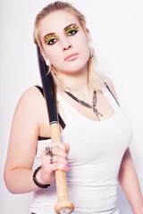 Beautiful blonde punk girl with a baseball bat