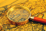 Old map and  magnifier glass