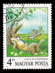 Slaked postage stamp in 1987 with a rabbit and a turtle