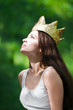 beautiful young woman wearing crown