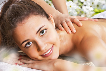 Girl getting a body massage at the day spa