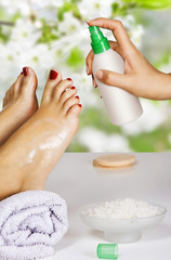 moisturizing the feet in the spa salon