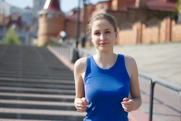 Young woman running and training