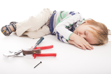 sleeping boy with hammer and pliers