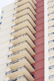 Tower of White Balconies by Red Wall