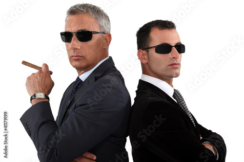 Powerful businessmen in sunglasses