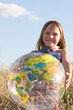 Happy girl with big globe