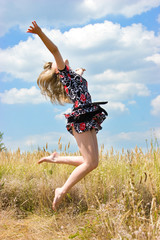 Happy beautiful girl jumping into the air