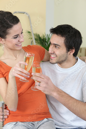 couple clinking glasses during moving