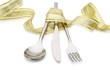 Spoon, fork and a knife tied up celebratory ribbon