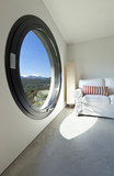 beautiful room with large porthole