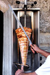 Doner kebab on it's special skewer.