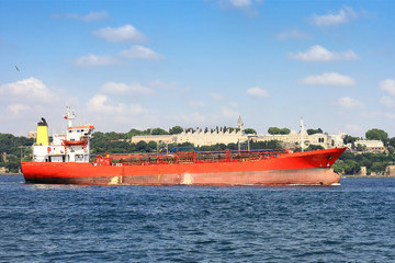 Red gas tanker sails in Bosporus