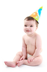 Happy baby wearing party hat