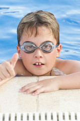 Boy with glasses enjoying the summer pool