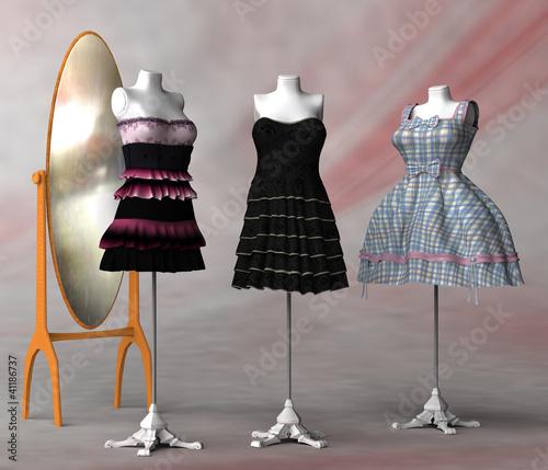 spiegel und drei kleiderst nder mit verschiedenen. Black Bedroom Furniture Sets. Home Design Ideas
