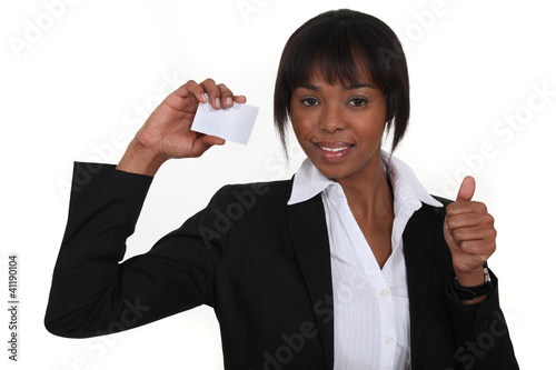 An African American businesswoman with her card.
