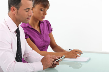 Business couple going over accounts