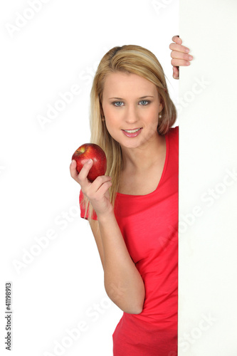 young woman holding an apple