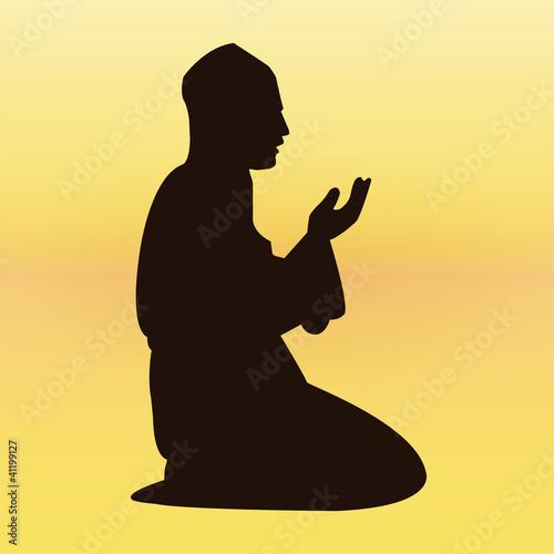 Praying man silhouette