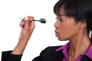 black beauty playing darts