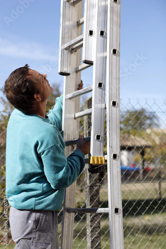 Man with a ladder outdoors
