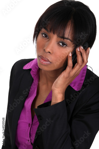 black businesswoman making a call isolated on white