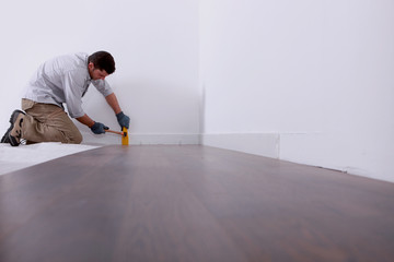 Artisan laying parquet