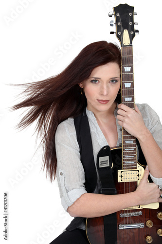Woman hugging her guitar