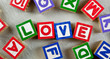 Wooden blocks forming the word LOVE in the center