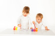 pretty baby girls painting in white studio