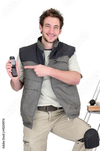 happy tiler showing mobile phone