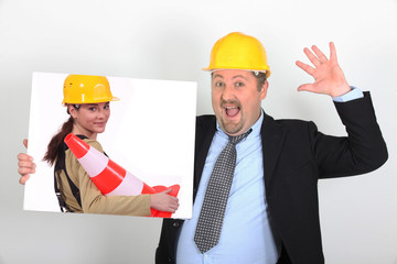 foreman holding picture of woman with construction cone