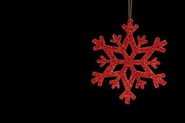 Red snow flake on a black background