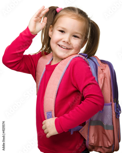 Portrait of a cute schoolgirl with backpack